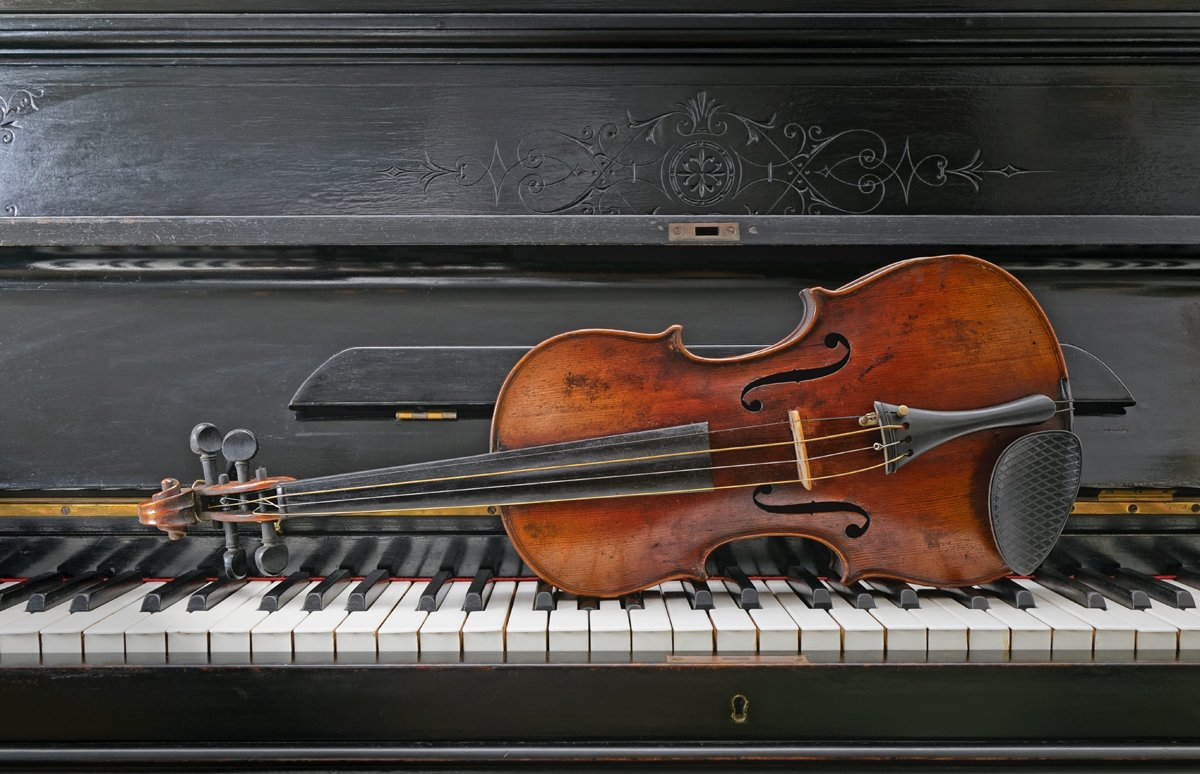 Private Music Training | close up Antique Violin and piano instruments